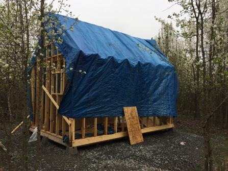 Tiny cabin with tarp - rainy March